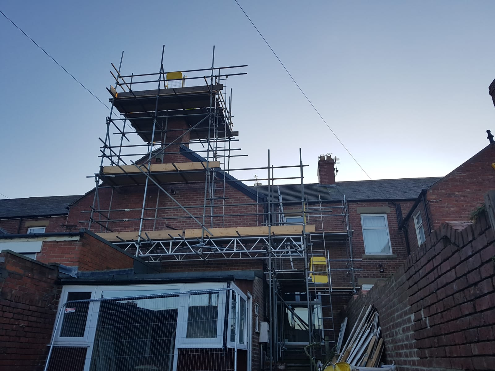 Chimney stack and beam work.